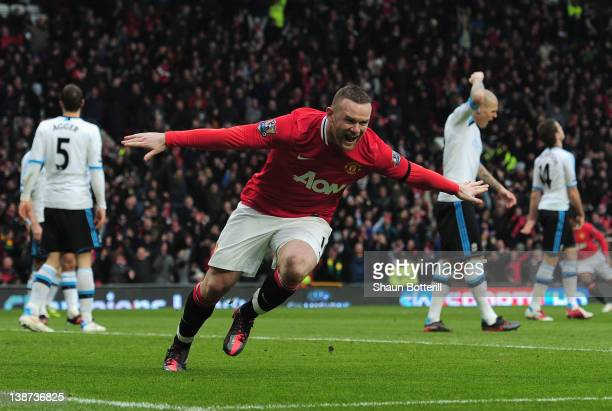 Wayne Rooney of Manchester United scores the opening goal during the Barclays Premier League match between Manchester United and Liverpool at Old...