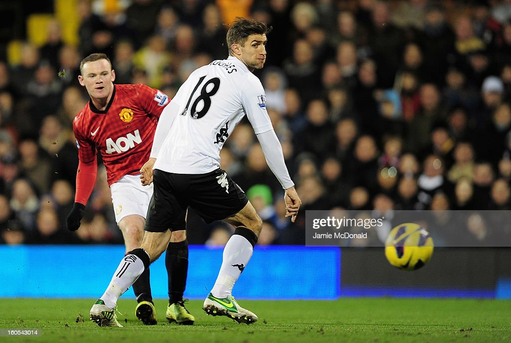 Wayne Rooney of Manchester United scores the opening goal during the Barclays Premier League match between Fulham and Manchester United at Craven Cottage on February 2, 2013 in London, England.
