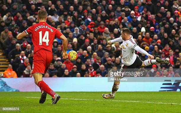 Wayne Rooney of Manchester United scores the opening goal during the Barclays Premier League match between Liverpool and Manchester United at Anfield...