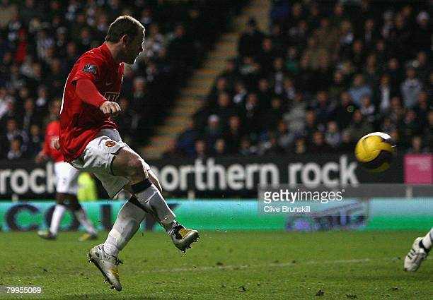 Wayne Rooney of Manchester United scores the opening goal during the Barclays Premier League match between Newcastle United and Manchester United at...