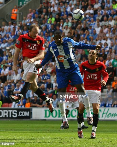 Wayne Rooney of Manchester United scores the opening goal during the Barclays Premier League match between Wigan Athletic and Manchester United at...