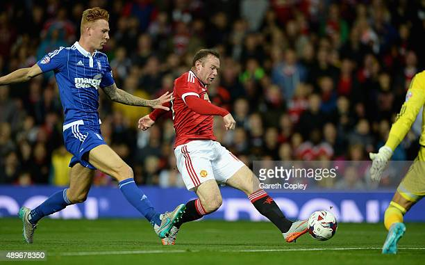 Wayne Rooney of Manchester United scores the opening goal past Josh Yorwerth of Ipswich Town during the Capital One Cup Third Round match between...