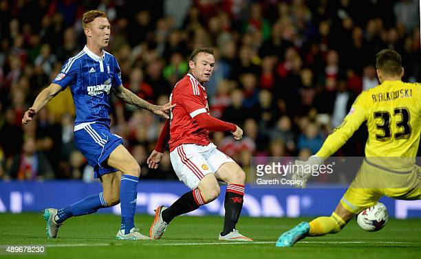 Wayne Rooney of Manchester United scores the opening goal past Bartosz Bialkowski of Ipswich Town during the Capital One Cup Third Round match...