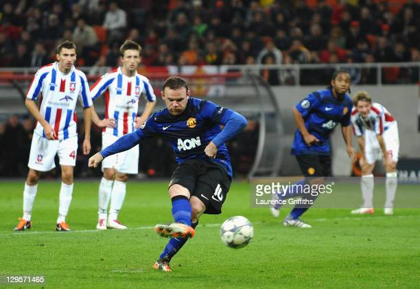Wayne Rooney of Manchester United scores the second goal from the penalty spot during the UEFA Champions League Group C match between FC Otelul...