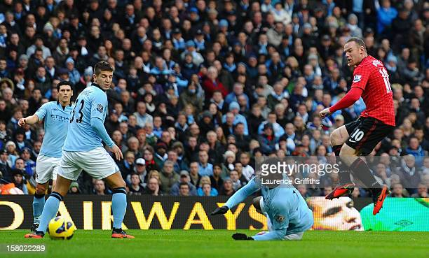 Wayne Rooney of Manchester United scores the second goal to make the score 02 during the Barclays Premier League match between Manchester City and...