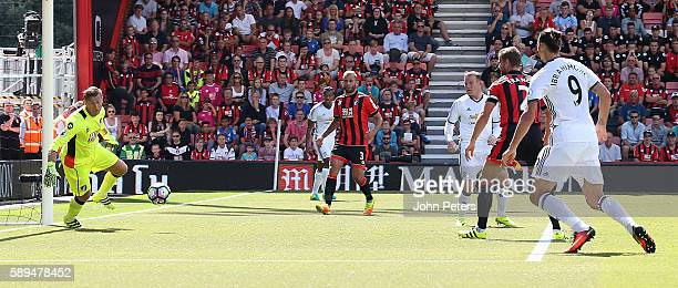 Wayne Rooney of Manchester United scores the second goal to make the score 02 during the Premier League match between AFC Bournemouth and Manchester...