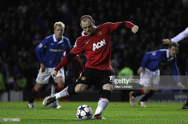 Wayne Rooney of Manchester United scores the winning goal from the penalty spot during the UEFA Champions League Group C match between Glasgow...