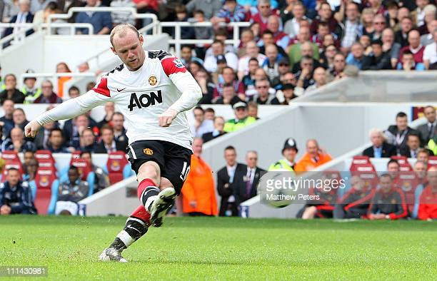 Wayne Rooney of Manchester United scores their first goal during the Barclays Premier League match between West Ham United and Manchester United at...