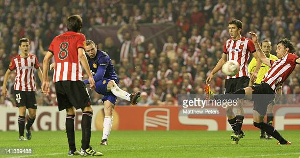 Wayne Rooney of Manchester United scores their first goal during the UEFA Europa League Round of 16 second leg match between Athletic Club of Bilbao...