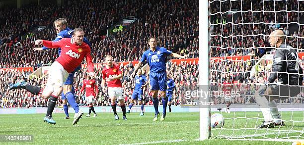 Wayne Rooney of Manchester United scores their first goal during the Barclays Premier League match between Manchester United and Everton at Old...