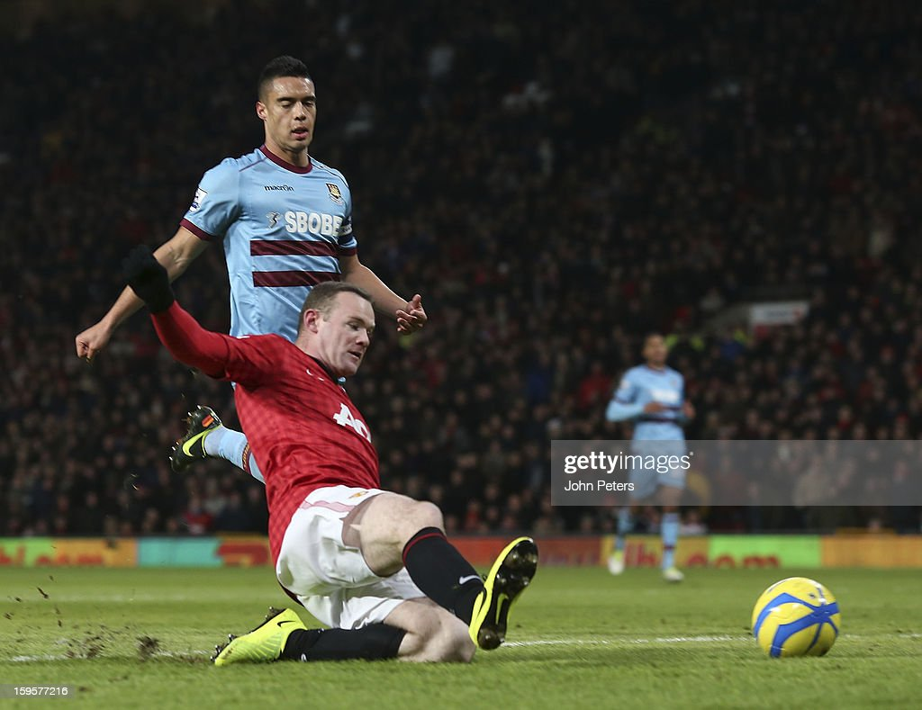 Wayne Rooney of Manchester United scores their first goal during the FA Cup Third Round Replay match between Manchester United and West Ham United at Old Trafford on January 16, 2013 in Manchester, England.