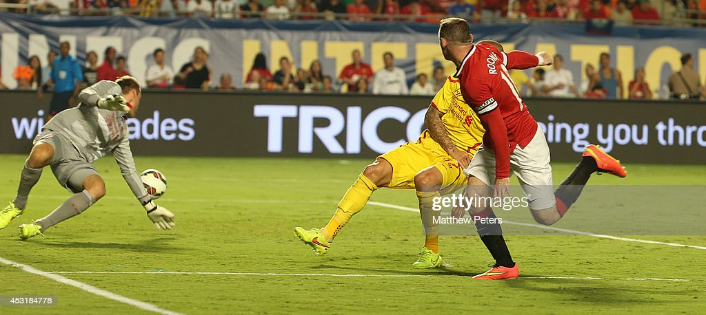 Wayne Rooney of Manchester United scores their first goal during the pre-season friendly match between Manchester United and Liverpool at Sun Life Stadium on August 4, 2014 in Miami Gardens, Florida.