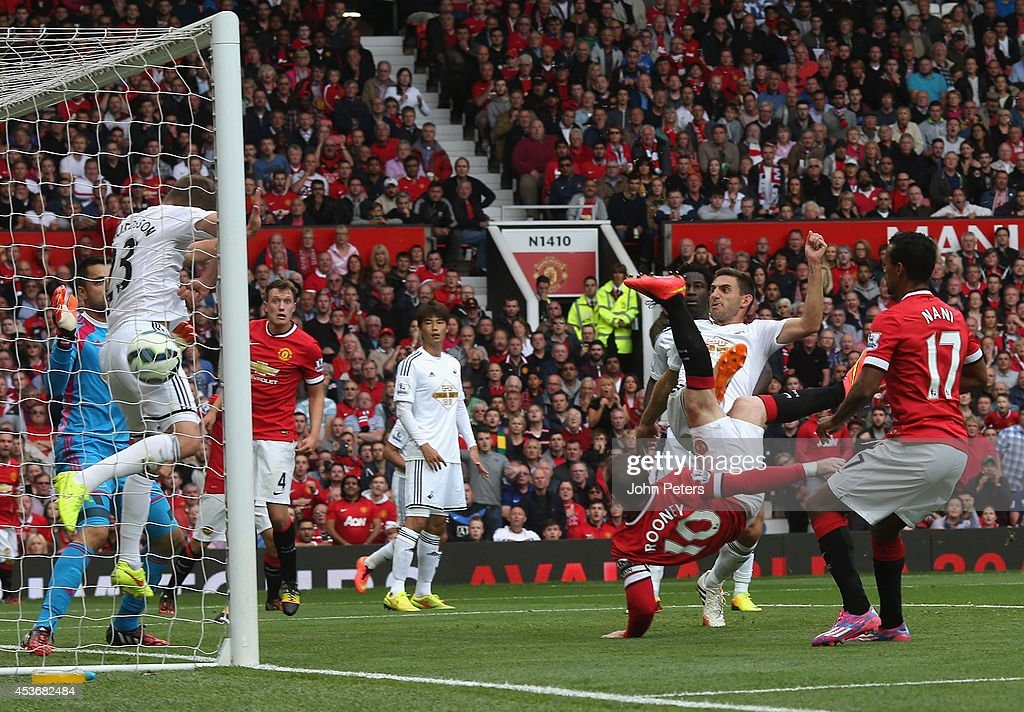 Wayne Rooney of Manchester United scores their first goal during the Premier League match between Manchester United and Swansea City at Old Trafford on August 16, 2014 in Manchester, England.