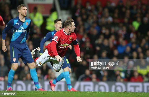Wayne Rooney of Manchester United scores their first goal during the FA Cup Quarter Final match between Manchester United and Arsenal at Old Trafford...