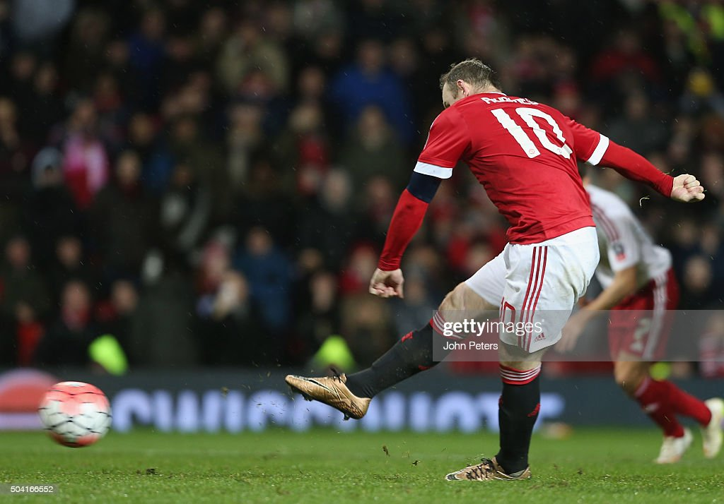 Wayne Rooney of Manchester United scores their first goal during the Emirates FA Cup Third Round match between Manchester United and Sheffield United at Old Trafford on January 9, 2016 in Manchester, England.