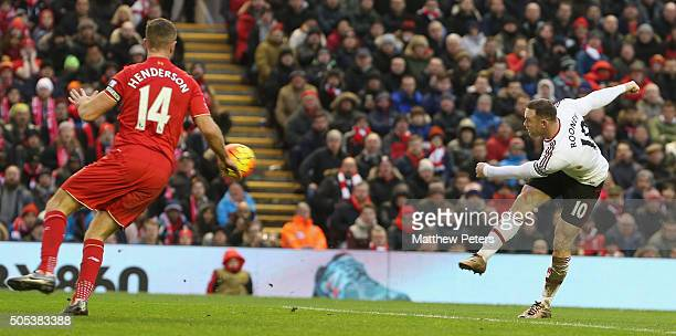 Wayne Rooney of Manchester United scores their first goal during the Barclays Premier League match between Liverpool and Manchester United at Anfield...
