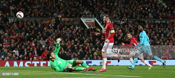 Wayne Rooney of Manchester United scores their first goal during the UEFA Europa League match between Manchester United FC and Feyenoord at Old...