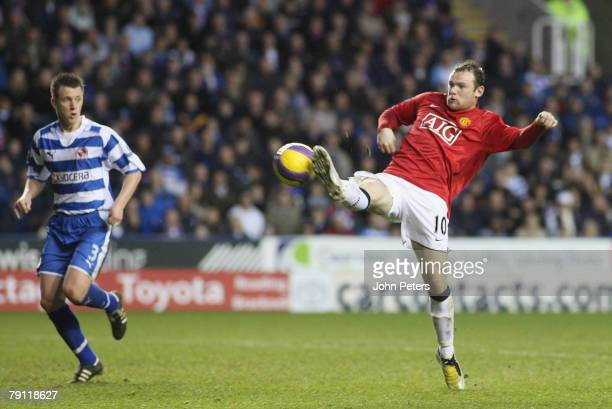 Wayne Rooney of Manchester United scores their first goal during the Barclays FA Premier League match between Reading and Manchester United at the...