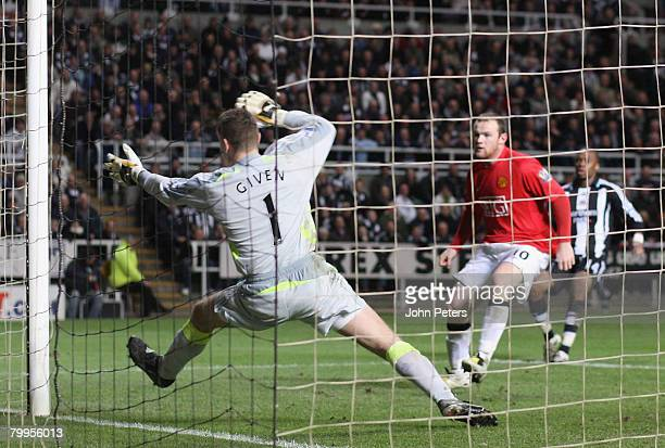 Wayne Rooney of Manchester United scores their first goal during the Barclays FA Premier League match between Newcastle United and Manchester United...