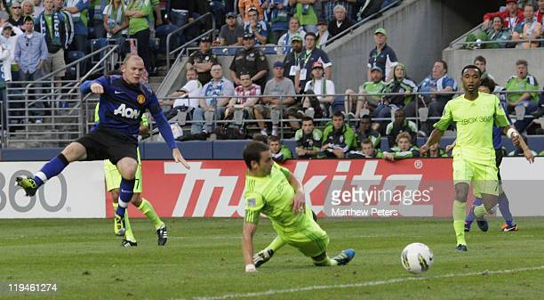 Wayne Rooney of Manchester United scores their fourth goal during the pre-season friendly match between Seattle Sounders and Manchester United at...
