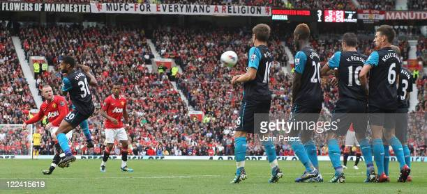 Wayne Rooney of Manchester United scores their fourth goal during the Barclays Premier League match betwen Manchester United and Arsenal at Old...