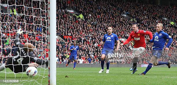 Wayne Rooney of Manchester United scores their fourth goal during the Barclays Premier League match between Manchester United and Everton at Old...