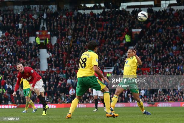 Wayne Rooney of Manchester United scores their fourth goal during the Barclays Premier League match between Manchester United and Norwich City at Old...