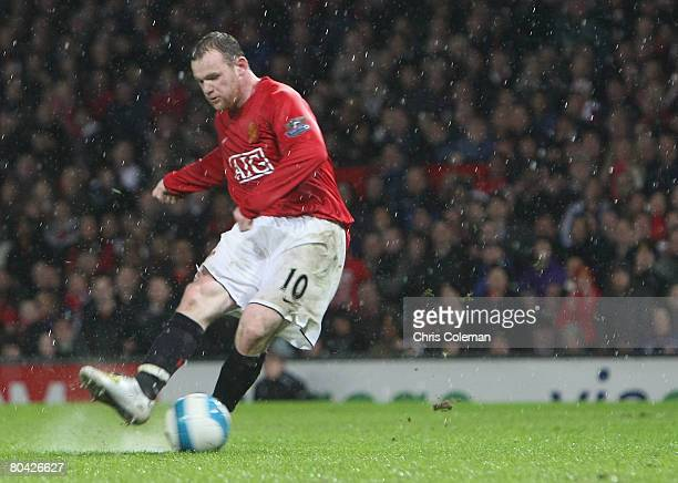 Wayne Rooney of Manchester United scores their fourth goal during the Barclays FA Premier League match between Manchester United and Aston Villa at...