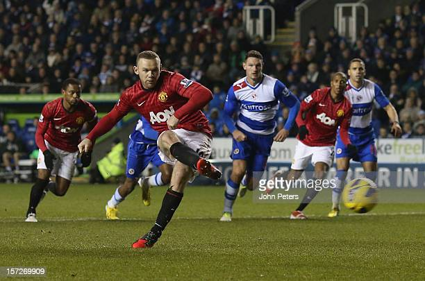 Wayne Rooney of Manchester United scores their second goal during the Barclays Premier League match between Reading and Manchester United at Madejski...
