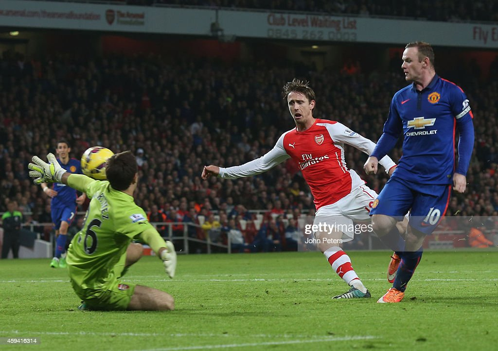 Wayne Rooney of Manchester United scores their second goal during the Barclays Premier League match between Arsenal and Manchester United at Emirates Stadium on November 22, 2014 in London, England.