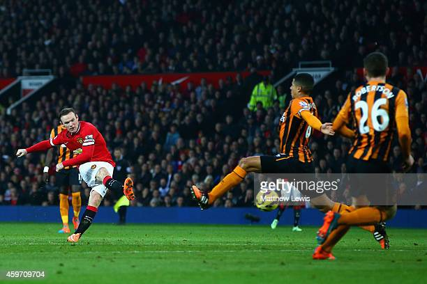 Wayne Rooney of Manchester United scores their second goal during the Barclays Premier League match between Manchester United and Hull City at Old...