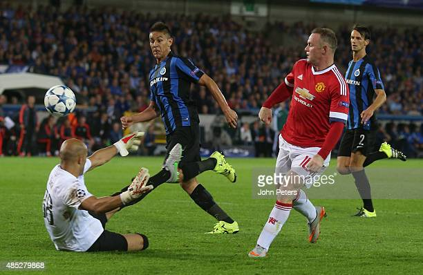 Wayne Rooney of Manchester United scores their second goal during the UEFA Champions League playoff second leg match between Club Brugge and...