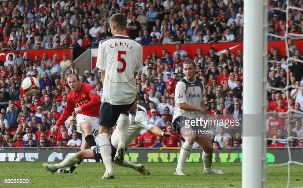 Wayne Rooney of Manchester United scores their second goal during the FA Premier League match between Manchester United and Bolton Wanderers at Old...