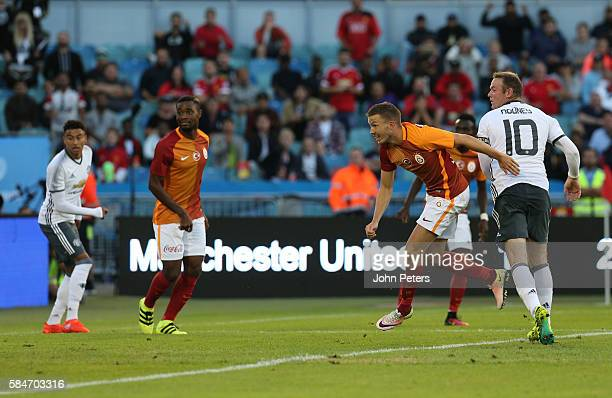 Wayne Rooney of Manchester United scores their second goal of Galatasary during the preseason friendly match between Manchester United and...