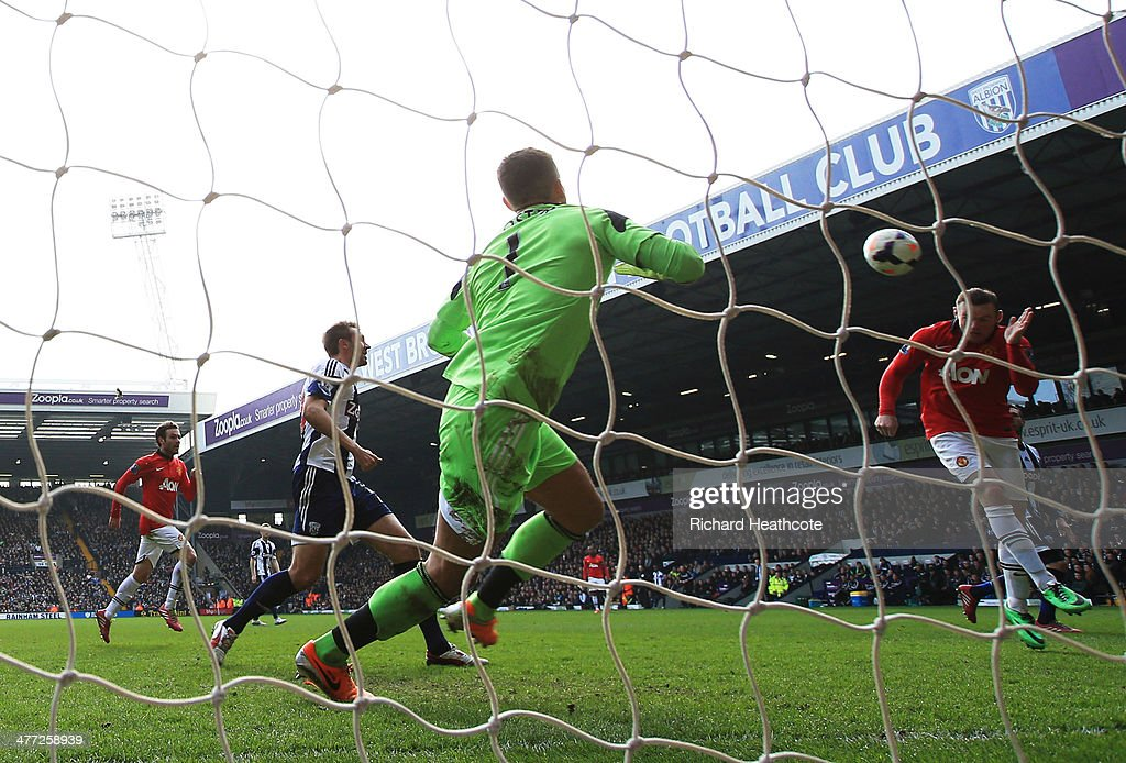 Wayne Rooney of Manchester United (L) scores their second goal with a header past goalkeeper Ben Forster of West Bromwich Albion during the Barclays Premier League match between West Bromwich Albion and Manchester United at The Hawthorns on March 8, 2014 in West Bromwich, England.