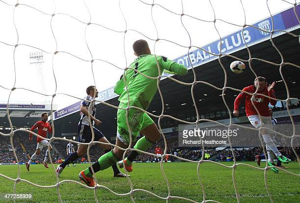 Wayne Rooney of Manchester United scores their second goal with a header past goalkeeper Ben Forster of West Bromwich Albion during the Barclays...