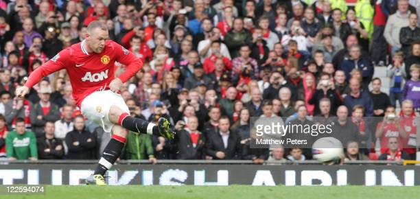 Wayne Rooney of Manchester United scores their seventh goal during the Barclays Premier League match between Manchester United and Arsenal at Old...