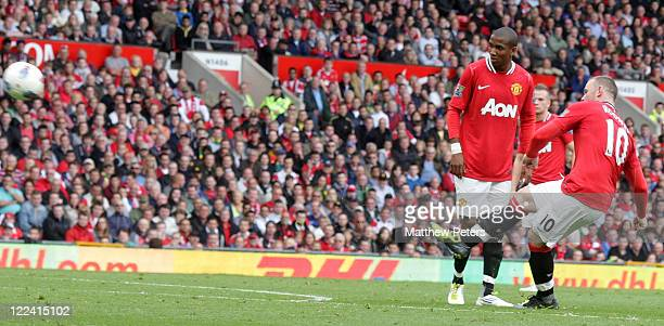 Wayne Rooney of Manchester United scores their third goal during the Barclays Premier League match between Manchester United and Arsenal at Old...