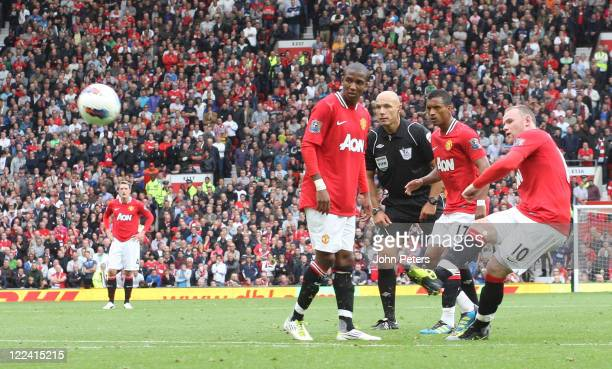 Wayne Rooney of Manchester United scores their third goal during the Barclays Premier League match betwen Manchester United and Arsenal at Old...