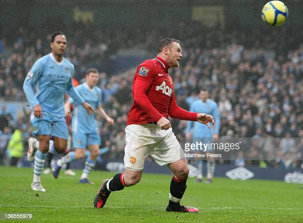 Wayne Rooney of Manchester United scores their third goal during the FA Cup Third Round match between Manchester City and Manchester United at Etihad...