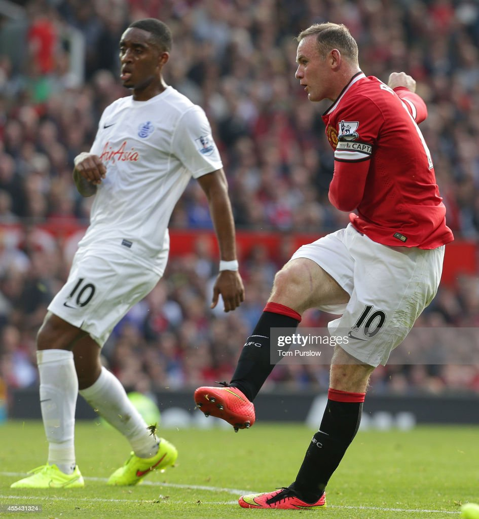 Wayne Rooney of Manchester United scores their third goal during the Barclays Premier League match between Manchester United and Queens Park Rangers at Old Trafford on September 14, 2014 in Manchester, England.