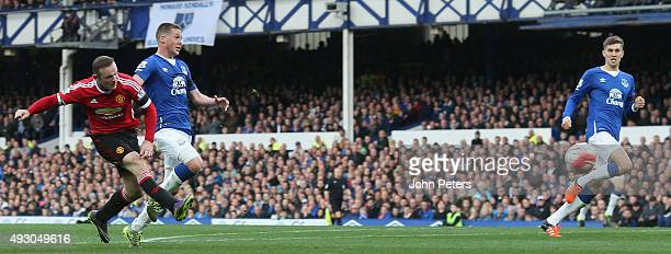 Wayne Rooney of Manchester United scores their third goal during the Barclays Premier League match between Everton and Manchester United at Goodison...