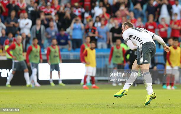 Wayne Rooney of Manchester United scores their third goal of Galatasary during the preseason friendly match between Manchester United and Galatasaray...