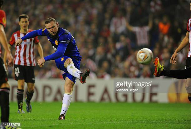 Wayne Rooney of Manchester United scores to make it 21 during the UEFA Europa League Round of 16 second leg match between Manchester United and...