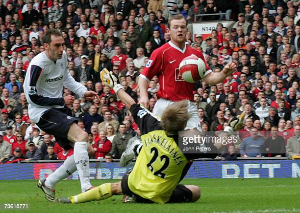Wayne Rooney of Manchester United scores United's second goal during the Barclays Premiership match between Manchester United and Bolton Wanderers at...