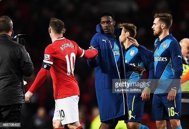 Wayne Rooney of Manchester United shakes hands with former teammate Danny Welbeck of Arsenal following the final whistle during the FA Cup Quarter...
