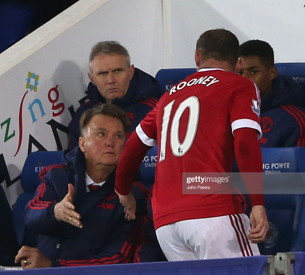 Wayne Rooney of Manchester United shakes hands with Manager Louis van Gaal after being substituted during the Barclays Premier League match between Leicester City and Manchester United at The King Power Stadium on November 28, 2015 in Leicester, England.