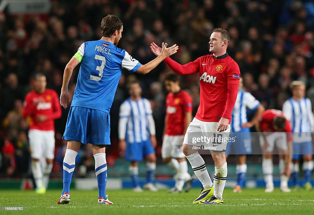 Wayne Rooney of Manchester United shakes hands with Mikel Gonzalez of Real Sociedad at the end of the UEFA Champions League Group A match between Manchester United and Real Sociedad at Old Trafford on October 23, 2013 in Manchester, England.
