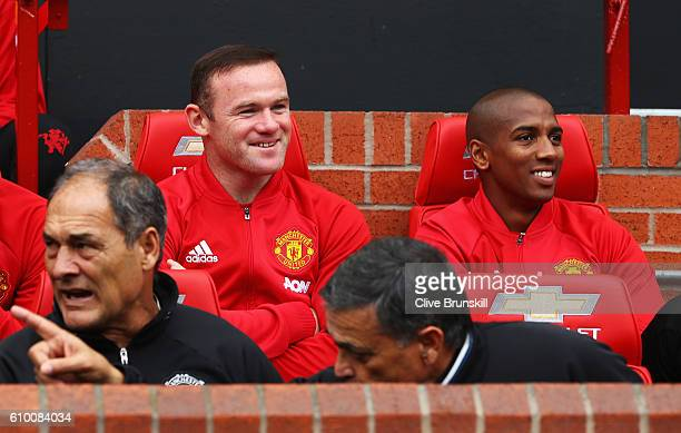 Wayne Rooney of Manchester United shares a smile with Ashley Young of Manchester United while sitting on the bench during the Premier League match...