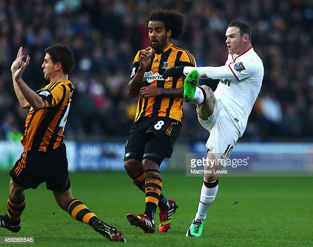 Wayne Rooney of Manchester United shoots and scores his sides second goal during the Barclays Premier League match between Hull City and Manchester...